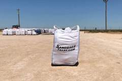 white-sandbags-container